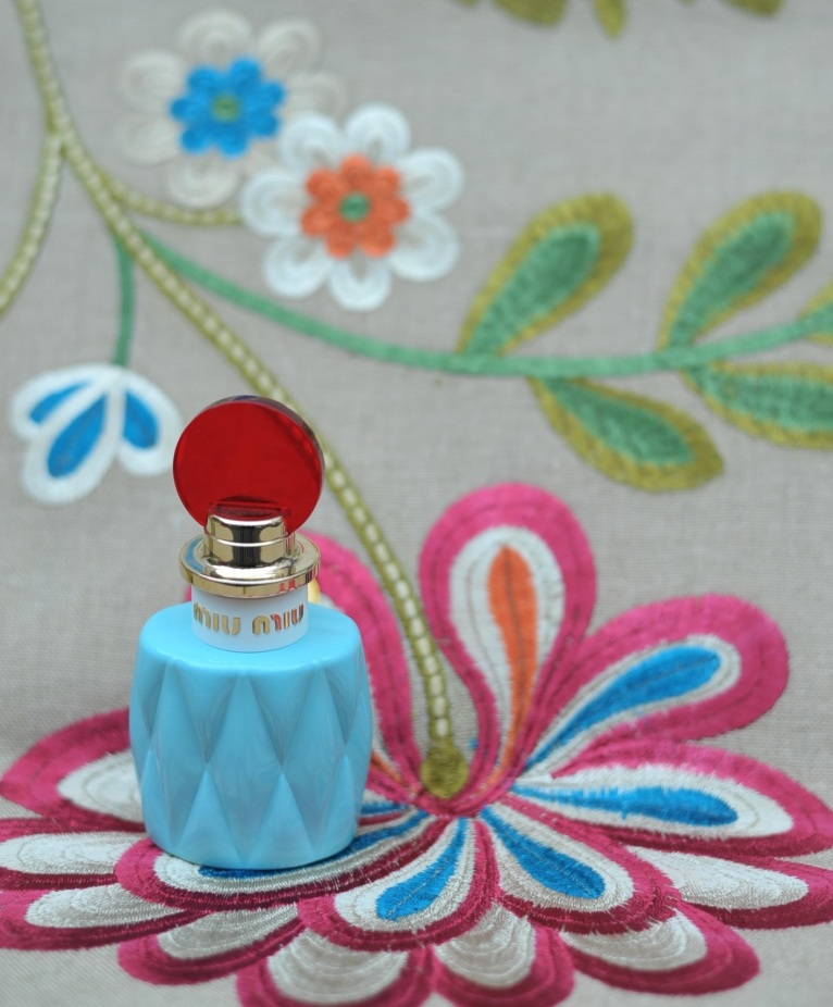 'Palampore Embroidery' from F Schumacher. Perfume by Miu Miu.