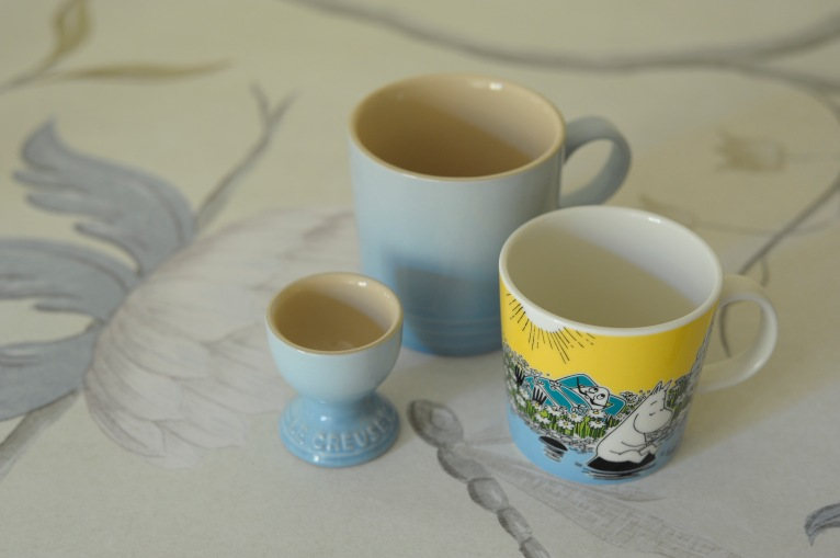 'Adams Eden' wallpaper by Lewis and Wood. Coastal Blue egg cup and mug from Le Creuset. 'Moment on the Shore' mug by Moomin